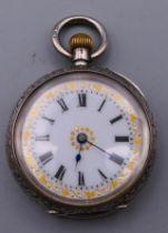 A 935 silver pocket watch. 3.25 cm diameter.