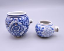 Two Chinese porcelain blue and white bird feeders. The largest 5.5 cm high.