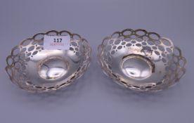 A pair of silver pierced dishes. 10 cm diameter. 76 grammes.