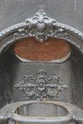 A cast iron fireplace.