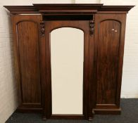 A Victorian mahogany breakfront triple wardrobe. 198.5 cm high x 216.5 cm wide.