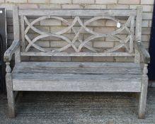 A garden bench. 124 cm wide.