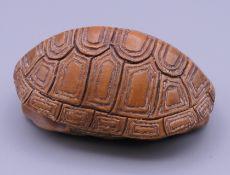 A 19th century netsuke formed as a tortoise shell. 5.5 x 4 cm.