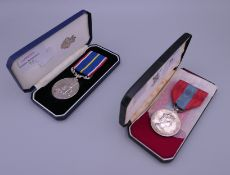 An Imperial Service medal awarded to James William Chandler and a National Service medal 1939-1960,