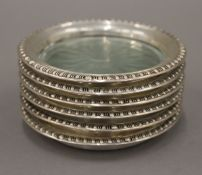 Six sterling silver mounted glass coasters. 9.5 cm diameter.