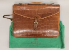 A Mulberry faux crocodile skin bag.
