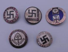 Five Nazi type badges. The largest 2.5 cm diameter.