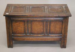 A small early 20th century oak coffer. 67 cm wide.