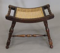 An early 20th century oak cane seated stool.