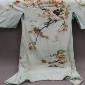 A Japanese embroidered silk kimono.