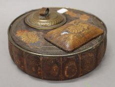 A Japanese lacquered smoking set. 21 cm diameter.