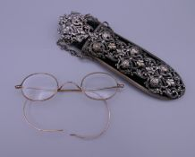 An ornate Victorian white metal and velvet chatelaine eye glass case and a pair of antique gold