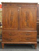 A 19th century mahogany linen press. 183 cm high x 142.5 cm wide.
