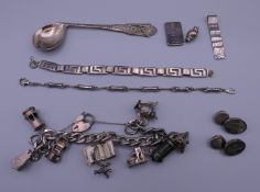 A quantity of silver, including a spoon, a pair of cufflinks,