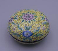 A Canton yellow enamel round box. 8 cm diameter.