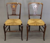 A pair of Victorian inlaid rush seated chairs.