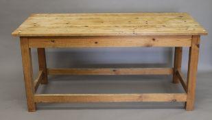 A modern pine kitchen table. 167 cm long.