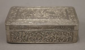 A 19th century Chinese silver box engraved with figures and trees, etc., seal marks to base.