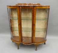 A mid-20th century display cabinet and a coffee table. The former 104 cm wide.