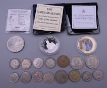 A small quantity of Commemorative coins and a fork. Fork 27 cm long.