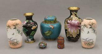 A collection of five cloisonne items and a pair of Chinese porcelain vases. The largest 18 cm high.