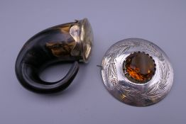A 19th century Scottish horn and silvered brass snuff mull and a large engraved circular cloak pin
