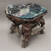 An Oriental florite and root wood stool. 51 cm high.
