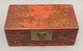 A 19th century Chinese red lacquered document box, painted with figures. 37 cm wide.