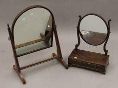Two 19th century mahogany toilet mirrors.