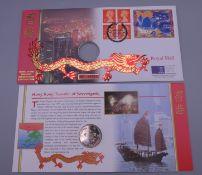 A 1997 Hong Kong coin and stamp set.