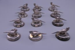 Twelve silver pheasant place name holders. 4.5 cm wide x 3 cm high.