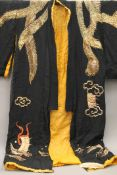 A Chinese embroidered robe.