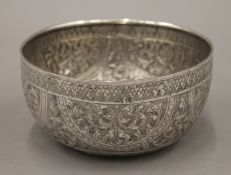 A 19th century hand tooled Thai silver bowl, stamps to base. 14 cm diameter. 115 grammes.