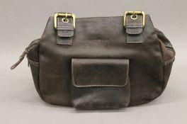 A Greenburry handbag.