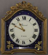 A small late 19th century French enamel decorated strutt clock. 11 cm high.