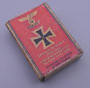 A WWII period Nazi matchbox. 5 x 3.75 cm.