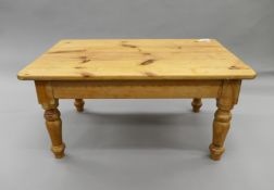 An early 20th century oak occasional table and a modern pine coffee table. The former 59 cm squared.