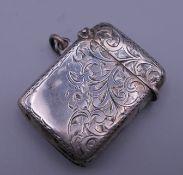 A silver vesta case. 4 x 2.75 cm.