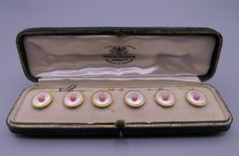A boxed set of six 18 ct gold studs, in a Goldsmiths & Silversmiths Company Ltd fitted case.