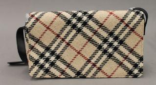 A Burberry of London handbag.