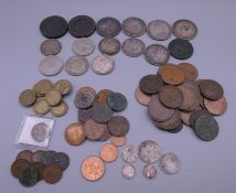 A coin collection, including silver. Approximately 6 troy ounces of silver.