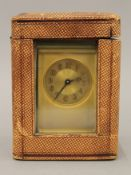 A 19th century brass carriage clock, housed in a travelling case. 15 cm high.