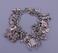 A silver charm bracelet. 20 cm long. 87 grammes total weight.