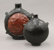 Two Chinese papier mache flasks. The largest 22.5 cm high.