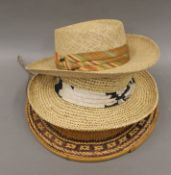 An Oriental straw hat, approximately size 7 1/8 and two straw hats, one by Bailey,