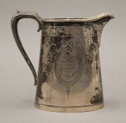 A Victorian silver presentation jug. 11.5 cm high. 218.9 grammes.
