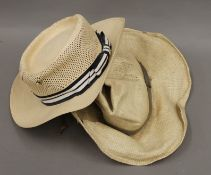 Two Panama straw hats, one by Adam, the other by Borsolino. Sizes 7 1/8 and 7 1/2.
