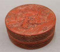 A 19th century Chinese carved cinnabar lacquer circular box. 13 cm diameter.