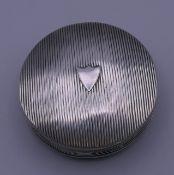 A Dutch silver round pill box. 5 cm diameter. 24.6 grammes.