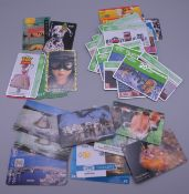 A selection of approximately 40 telephone phone cards.